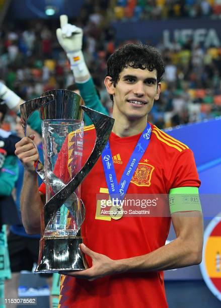 Jesús Vallejo of Spain celebrates the victory with the trophy at the end the 2019 UEFA U-21 Final between Spain and Germany at Stadio Friuli on June...
