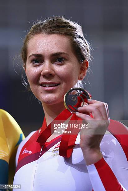Jess Varnish of England celebrates with her bronze medal after the Women's Sprint Final at Sir Chris Hoy Velodrome during day four of the Glasgow...
