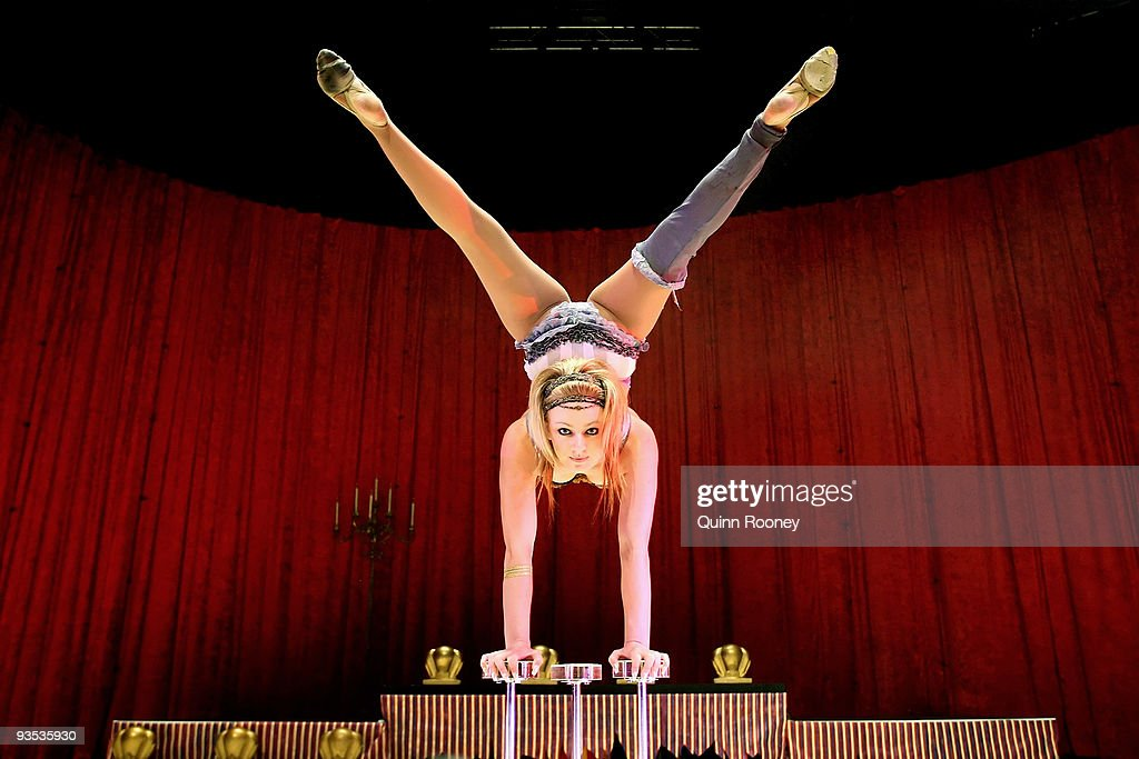 Jess Ward perform handstands on three canes as graduates perform at the National Institute of Circus Arts on December 2, 2009 in Melbourne, Australia.