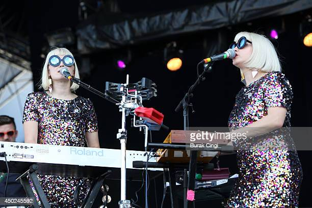 Jess Wolfe and Holly Laessig of Lucius perform on stage at Randall's Island on June 7 2014 in New York United States