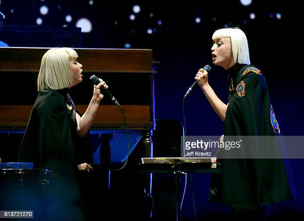 Jess Wolfe and Holly Laessig of Lucius perform with Roger Waters during Desert Trip at the Empire Polo Field on October 9 2016 in Indio California