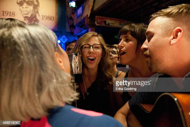 Jess Wolfe of Lucius Rachel Price and Bridget Kearney of Lake Street Dive and members of their bands perform in the crowd at Tipitina's on October 1...