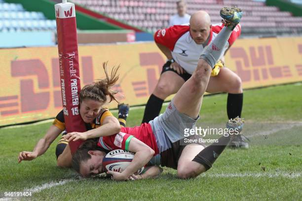 Jess Wooden of Harlequins Ladies scores a try as she is tackled by Tova Derk of Wasps FC Ladies during the Tyrrells Premier 15s Semi Final 2nd Leg...