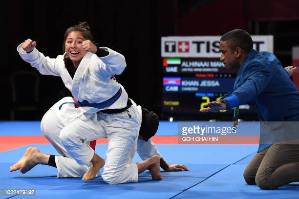 Jessa Khan of Cambodia celebrates after beating Mahra Alhinaai of United Arab Emirates in the jujitsu newaza women's under 49kg finals during the...