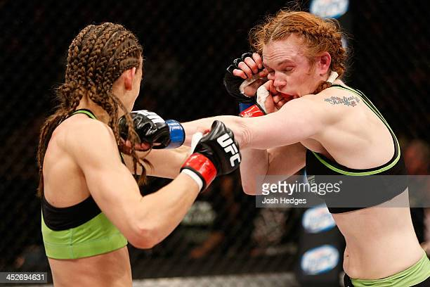 Jessamyn Duke punches Peggy Morgan in their women's bantamweight fight during The Ultimate Fighter season 18 live finale inside the Mandalay Bay...