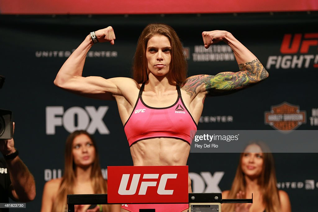 Jessamyn Duke steps on the scale during the UFC weigh-in at the United Center on July 24, 2015 in Chicago, Illinois.