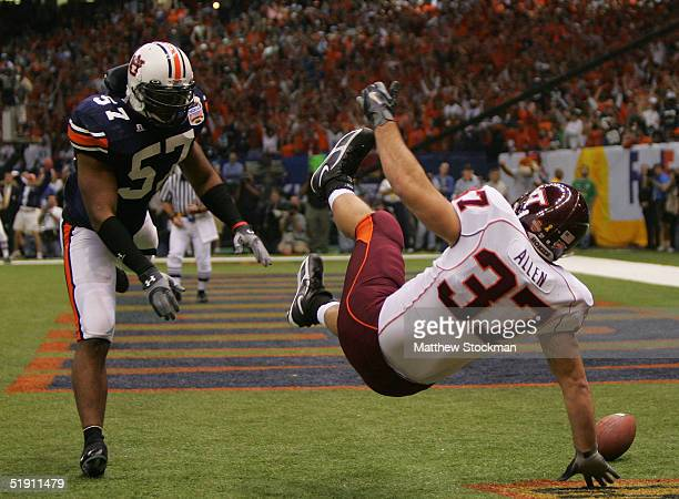 Jesse Allen of the Virginia Tech Hokies misses a touchdown catch while Mayo Sowell of the Auburn Tigers defends during the Nokia Sugar Bowl on...