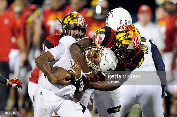 Jesse Aniebonam of the Maryland Terrapins tackles Maurice Alexander of the FIU Panthers at FIU Stadium on September 9 2016 in Miami Florida