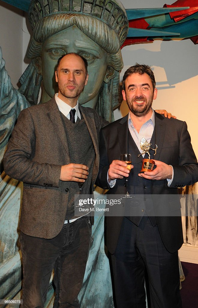 Jesse Armstrong and Simon Blackwell with the Best Screenplay Award for 'In The Loop' attend the London Evening Standard British Film Awards 2010, at The London Film Museum on February 8, 2010 in London, England.
