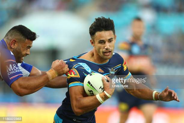 Jesse Arthars of the Titans is tackled during the round 10 NRL match between the Gold Coast Titans and the Canterbury Bulldogs at Cbus Super Stadium...