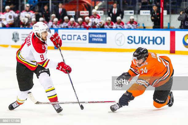 Jesse Blacker of HC Kunlun Red Star and Alexander Frolov of Amur Khabarovsk vie for the puck during the 2017/18 Kontinental Hockey League KHL Regular...