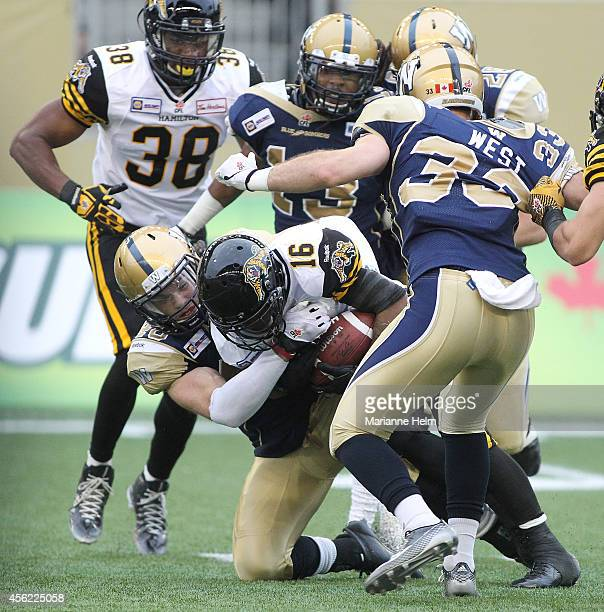 Jesse Briggs of the Winnipeg Blue Bombers takes down Brandon Banks of the Hamilton TigerCats in first half action in a CFL game at Investors Group...