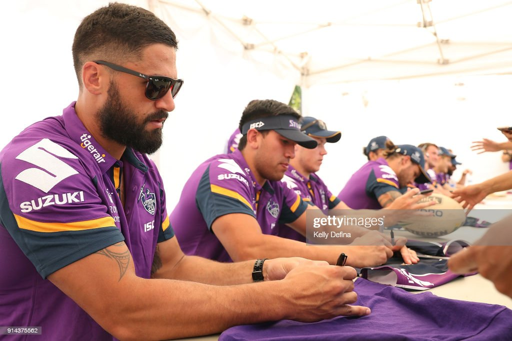 Jesse Bromwich and players sign autographs for fans during the Melbourne Storm Family Day on February 3, 2018 in Melbourne, Australia.