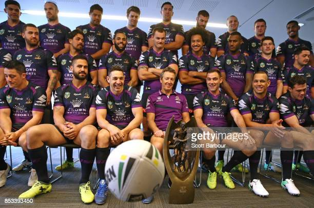 Jesse Bromwich Billy Slater coach Craig Bellamy captain Cameron Smith and Will Chambers watch as a ball bounces as they pose for their team photo...