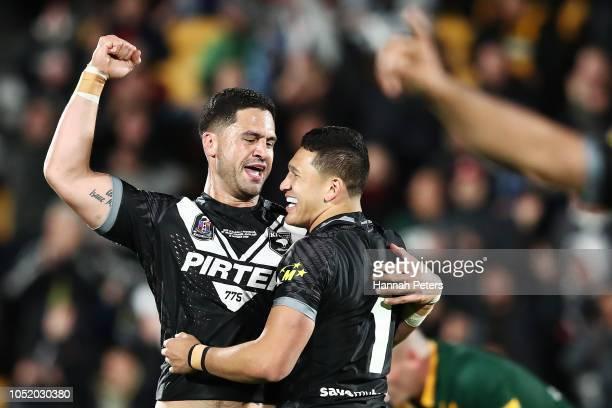 Jesse Bromwich celebrates with Dallin Watene Zelezniak of the Kiwis after winning the international Rugby League Test Match between the New Zealand...