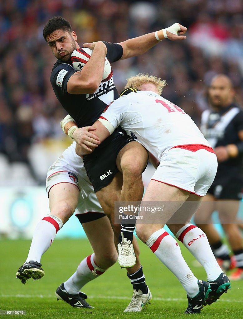 Jesse Bromwich of New Zealand is tackled by Sean O'Loughlin of England during the International Rugby League Test Series match between England and New Zealand at the Olympic Stadium on November 7, 2015 in London, England.