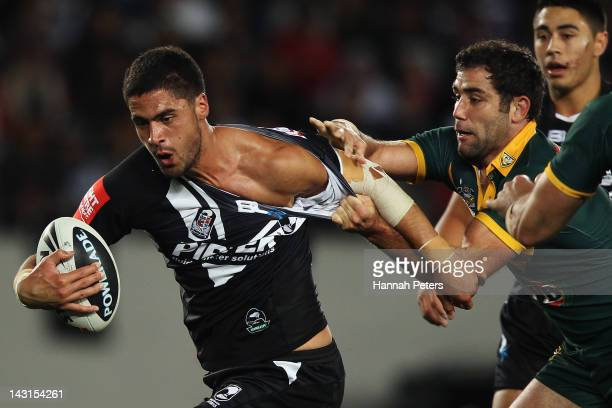 Jesse Bromwich of the Kiwis tries to get away from Cameron Smith of the Kangaroos during the ANZAC Test match between the New Zealand Kiwis and the...