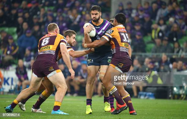 Jesse Bromwich of the Melbourne Storm is tackled during the round 14 NRL match between the Melbourne Storm and the Brisbane Broncos at AAMI Park on...