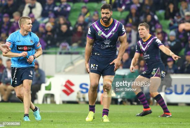 Jesse Bromwich of the Melbourne Storm leaves the field injured during the round 14 NRL match between the Melbourne Storm and the Brisbane Broncos at...