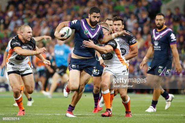 Jesse Bromwich of the Melbourne Storm runs with the ball during the round two NRL match between the Melbourne Storm and the Wests Tigers at AAMI Park...
