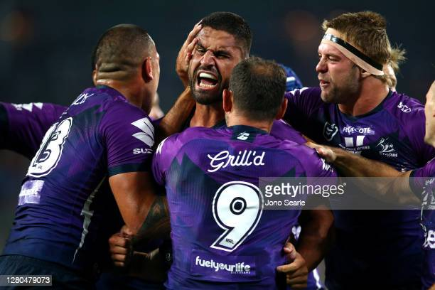 Jesse Bromwich of the Storm celebrates a try during the NRL Preliminary Final match between the Melbourne Storm and the Canberra Raiders at Suncorp...