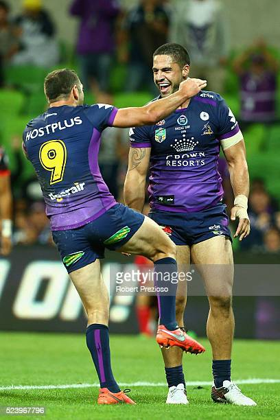 Jesse Bromwich of the Storm celebrates a try with teammate Cameron Smith of the Storm during the round eight NRL match between the Melbourne Storm...