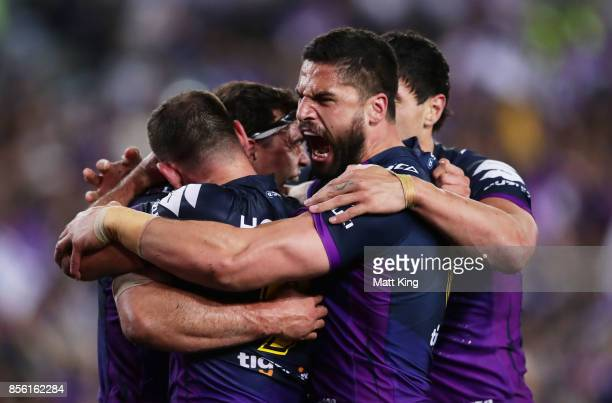 Jesse Bromwich of the Storm celebrates the try to Dale Finucane with team mates during the 2017 NRL Grand Final match between the Melbourne Storm and...