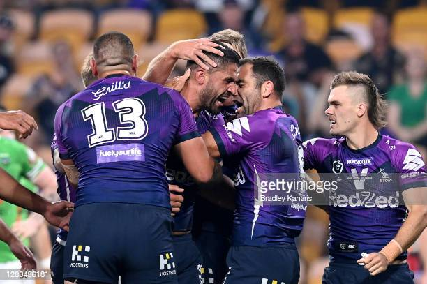 Jesse Bromwich of the Storm celebrates with team mate Cameron Smith during the NRL Preliminary Final match between the Melbourne Storm and the...