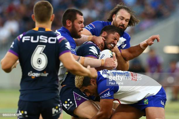 Jesse Bromwich of the Storm gets tackled during the round one NRL match between the Canterbury Bulldogs and the Melbourne Storm at Optus Stadium on...