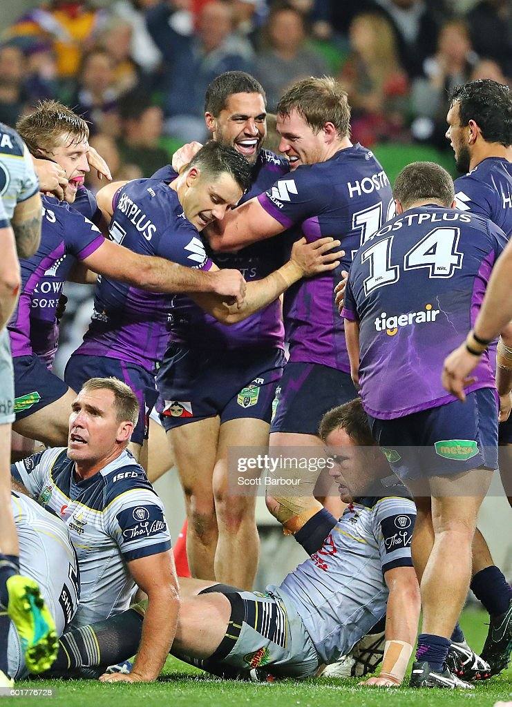 Jesse Bromwich of the Storm is congratulated by Cooper Cronk and his teammates after scoring their second try during the NRL Qualifying Final match between the Melbourne Storm and the North Queensland Cowboys at AAMI Park on September 10, 2016 in Melbourne, Australia.