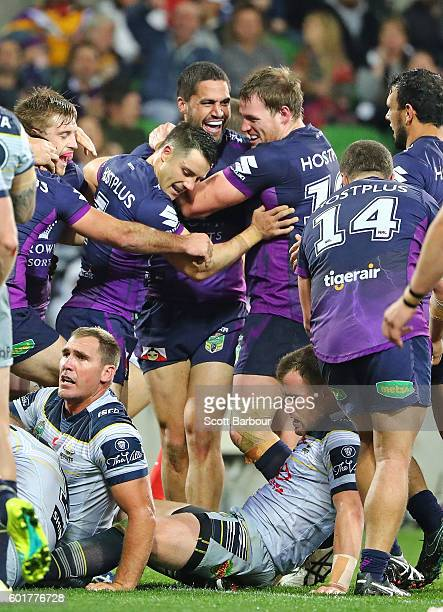 Jesse Bromwich of the Storm is congratulated by Cooper Cronk and his teammates after scoring their second try during the NRL Qualifying Final match...