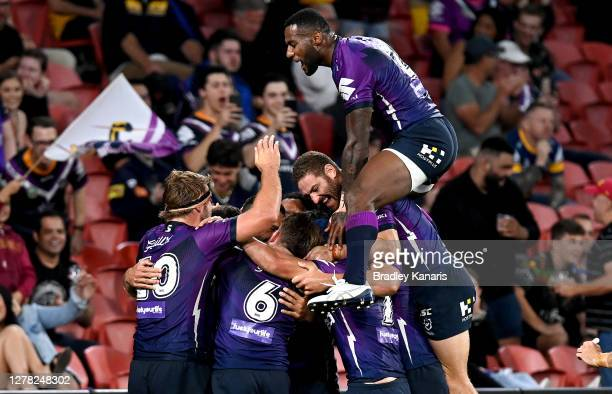 Jesse Bromwich of the Storm is congratulated by team mates after scoring a try during the NRL Qualifying Final match between the Melbourne Storm and...