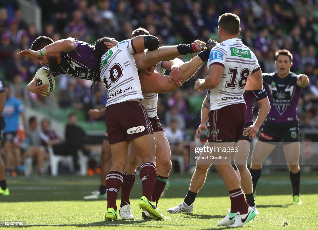 Jesse Bromwich of the Storm is lifted by Martin Taupau of the Sea Eagles during the round 21 NRL match between the Melbourne Storm and the Manly Sea Eagles at AAMI Park on July 30, 2017 in Melbourne, Australia.