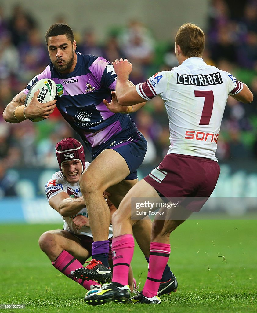 Jesse Bromwich of the Storm is tackled by Daly Cherry-Evans of the Sea Eagles during the round 10 NRL match between the Melbourne Storm and the Manly Sea Eagles at AAMI Park on May 20, 2013 in Melbourne, Australia.
