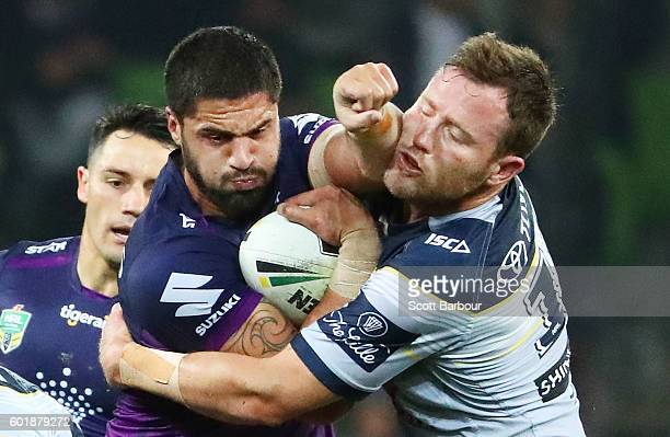 Jesse Bromwich of the Storm is tackled by Gavin Cooper of the Cowboys during the NRL Qualifying Final match between the Melbourne Storm and the North...