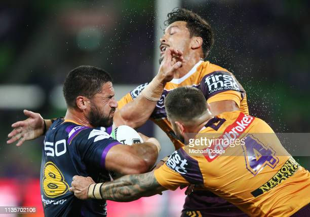 Jesse Bromwich of the Storm is tackled by Jack Bird of the Broncos during the round one NRL match between the Melbourne Storm and the Brisbane...