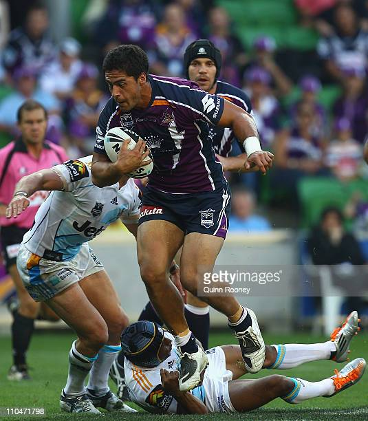Jesse Bromwich of the Storm is tackled by Preston Campbell of the Titans during the round two NRL match between the Melbourne Storm and the Gold...
