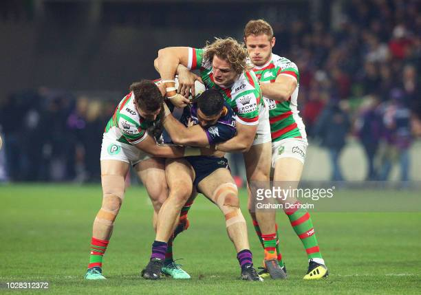 Jesse Bromwich of the Storm is tackled by the Rabbitohs defence during the NRL Qualifying Final match between the Melbourne Storm and the South...