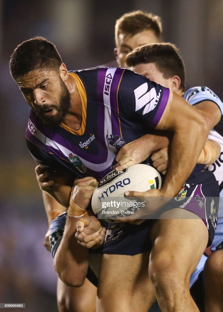 Jesse Bromwich of the Storm is tackled by the Sharks defence during the round four NRL match between the Cronulla Sharks and the Melbourne Storm at Southern Cross Group Stadium on March 30, 2018 in Sydney, Australia.