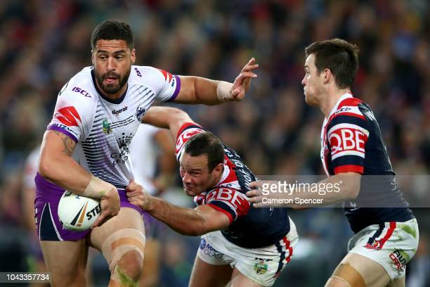 Jesse Bromwich of the Storm is tackled during the 2018 NRL Grand Final match between the Melbourne Storm and the Sydney Roosters at ANZ Stadium on...