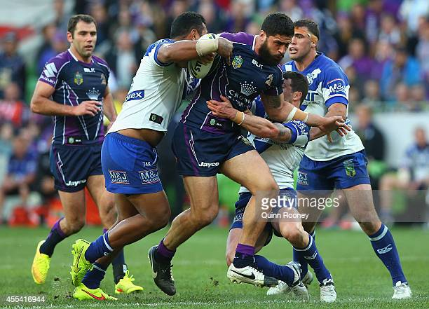 Jesse Bromwich of the Storm is tackled during the NRL 2nd Elimination Final match between the Melbourne Storm and the Canterbury Bankstown Bulldogs...