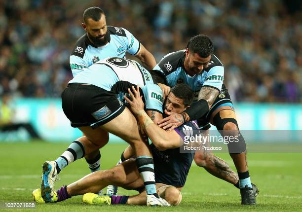 Jesse Bromwich of the Storm is tackled during the NRL Preliminary Final match between the Melbourne Storm and the Cronulla Sharks at AAMI Park on...