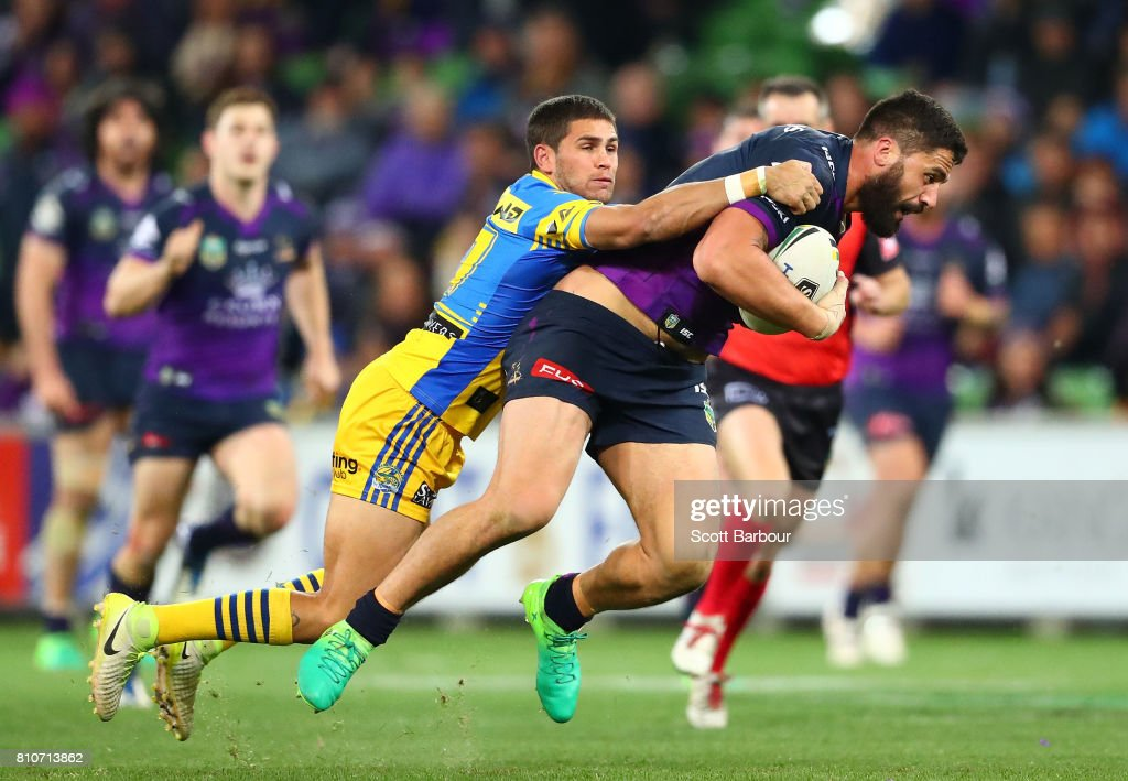 Jesse Bromwich of the Storm is tackled during the round 18 NRL match between the Melbourne Storm and the Parramatta Eels at AAMI Park on July 8, 2017 in Melbourne, Australia.