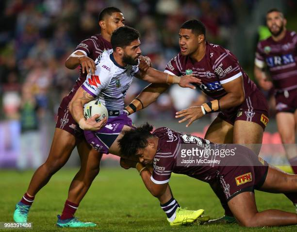 Jesse Bromwich of the Storm is tackled during the round 18 NRL match between the Manly Sea Eagles and the Melbourne Storm at Lottoland on July 14...
