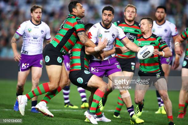 Jesse Bromwich of the Storm is tackled during the round 21 NRL match between the South Sydney Rabbitohs and the Melbourne Storm at ANZ Stadium on...