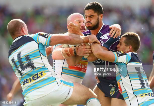 Jesse Bromwich of the Storm is tackled during the round five NRL match between the Melbourne Storm and the Gold Coast Titans at AAMI Park on April 6,...