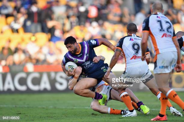Jesse Bromwich of the Storm is tackled during the round five NRL match between the Wests Tigers and the Melbourne Storm at Mt Smart Stadium on April...