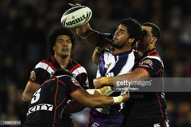 Jesse Bromwich of the Storm offloads the ball during the round 13 NRL match between the New Zealand Warriors and the Melbourne Storm at Mt Smart...