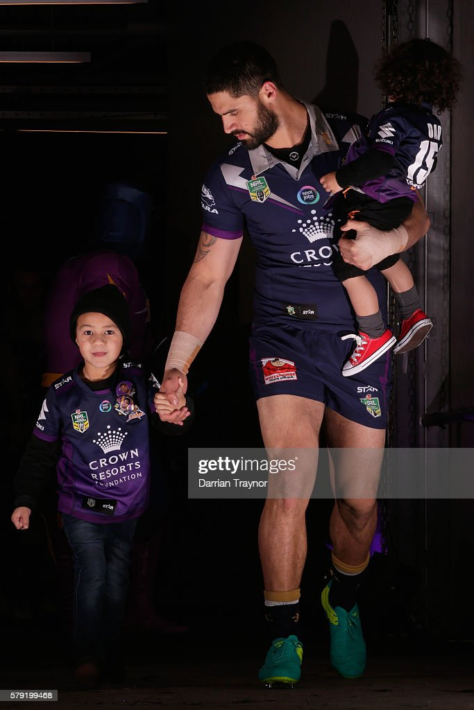 Jesse Bromwich of the Storm runs out with his boys before his 150th game before the round 20 NRL match between the Melbourne Storm and the Sydney Roosters at AAMI Park on July 23, 2016 in Melbourne, Australia.