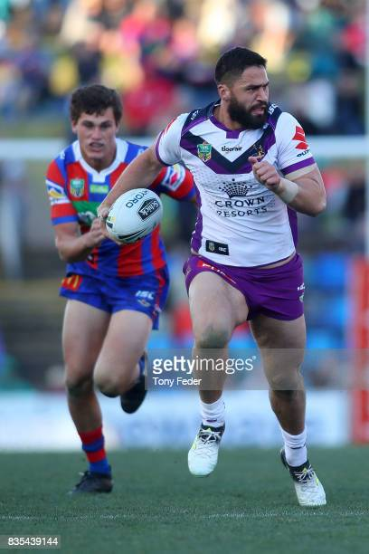 Jesse Bromwich of the Storm runs the ball during the round 24 NRL match between the Newcastle Knights and the Melbourne Storm at McDonald Jones...